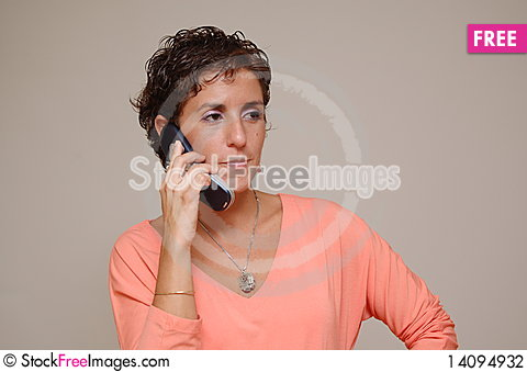 Free Young Woman Talking On Cell Phone Stock Photography - 14094932