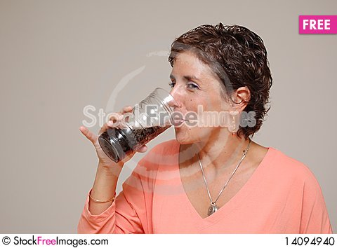 Free Young Woman Drinking Soda Stock Photo - 14094940