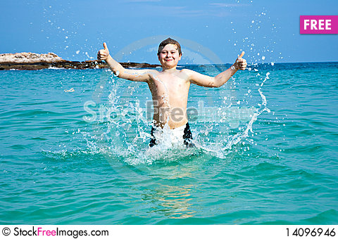 Free Smiling Boy Enjoys Swimming  In The Sea Royalty Free Stock Image - 14096946