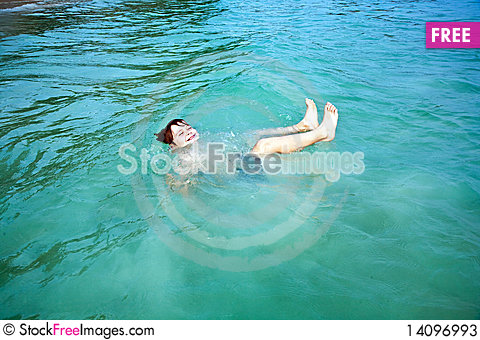 Free Smiling Boy Enjoys Swimming  In The Sea Stock Photos - 14096993