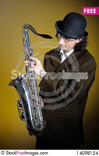 Free Young Retro Man In Bowler Hat With Music Saxophone Stock Images - 14098154