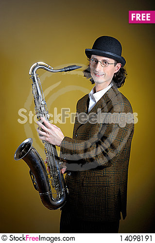 Free Young Retro Man In Bowler Hat With Music Saxophone Stock Image - 14098191