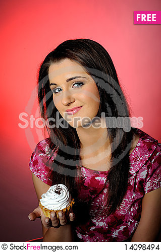 Free Young Beautiful Girl Eating Small Sweet Cake Stock Images - 14098494