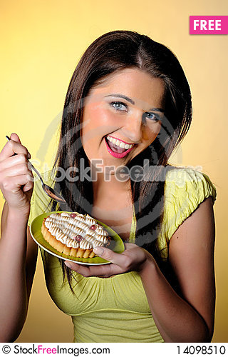 Free Young Beautiful Girl Eating Small Sweet Cake Stock Photo - 14098510