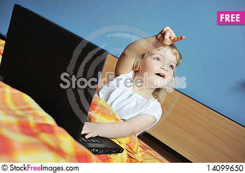 Free Little Girl With Laptop Stock Photo - 14099650