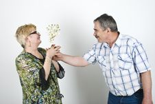 Free Middle Aged Man Giving Flowers To His Wife Stock Photo - 14090250