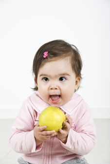 Cheerful Baby Ready To Bite An Apple Royalty Free Stock Images