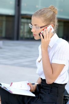 Free Young And Attractive Businesswoman With A Phone Royalty Free Stock Image - 14091846