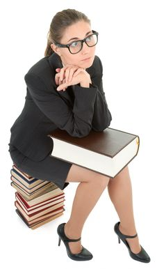 Free Woman And A Pile Of Books Royalty Free Stock Photo - 14092155
