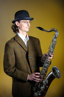 Young Retro Man In Bowler Hat With Music Saxophone Stock Photo