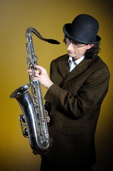 Young Retro Man In Bowler Hat With Music Saxophone Stock Images