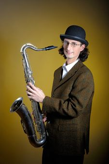 Young Retro Man In Bowler Hat With Music Saxophone Stock Image