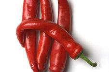 Free Four Red Hot Chilli Peppers Closeup Royalty Free Stock Images - 1410459