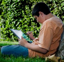 Free Student With His New Touch Pad Laptop Royalty Free Stock Photo - 1411015
