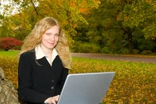 Free Woman With Laptop In Park. Royalty Free Stock Images - 1411589