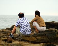 Free Couple Watching The Waves Royalty Free Stock Photography - 1413677