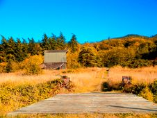 Wooden Bridge And Barn Royalty Free Stock Photography