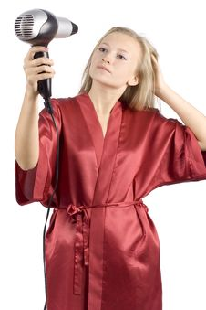 Free Young Woman Dressed Red Bathrobe Using  Hair Drier Royalty Free Stock Image - 1416666