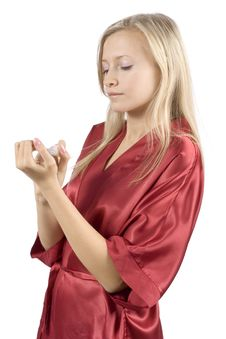 Free Young Woman Dressed Red Bathrobe Painting Nails Stock Photography - 1416672