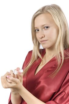 Free Young Woman Dressed Red Bathrobe Painting Nails Stock Image - 1416701