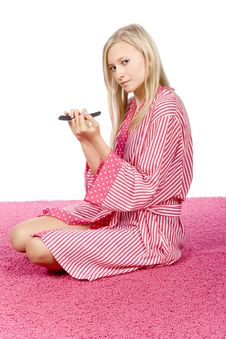 Free Young Woman Dressed Pink/white Bathrobe Filing Nails Royalty Free Stock Photo - 1416855