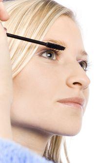 Free Closeup Of Young Woman S Face Putting Mascara Stock Photos - 1416973