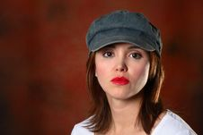 Free Brunette With Cap Red Backdrop Stock Photo - 1419020