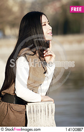 Free Asian Girl Outdoors Royalty Free Stock Photography - 14100887