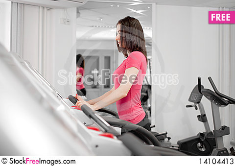 Free Woman On A Running Simulator Stock Photos - 14104413