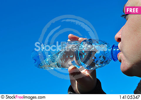Free Water. Girl Drinks From The Bottle. Royalty Free Stock Photography - 14105347