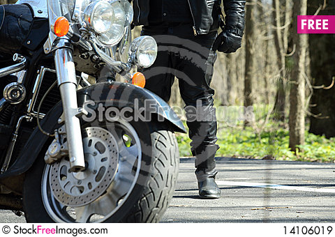 Free Biker Stands Near His Bike Royalty Free Stock Images - 14106019