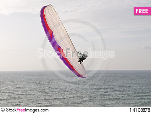 Free Paraglider Diving Toward The Sea Royalty Free Stock Photos - 14108878