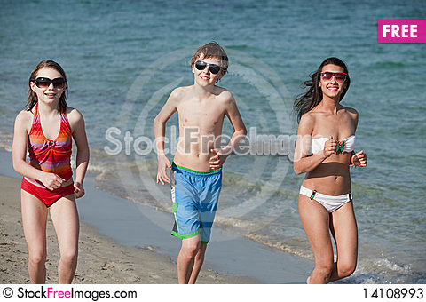 Free Teenagers Jogging Along The Shoreline Stock Photos - 14108993