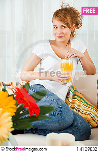 Free Beauty, Young Girl With A Glass Of Orange Juice Stock Photography - 14109832