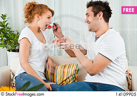 Free Young Boy Feeding A Beauty Girl  Strawberry Royalty Free Stock Photo - 14109905