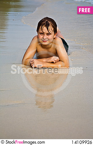 Free Young Happy Boy At The Beach Royalty Free Stock Image - 14109926