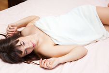 Free Young Girl Is Lying On A Bed Stock Images - 14104674