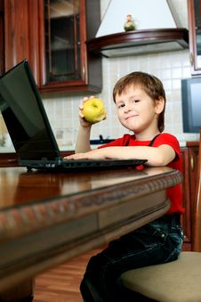 Little Boy With Laptop Stock Photo