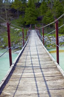 Free Hanging Wooden Bridge Over A River Stock Images - 14109484