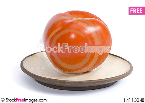 Free Tomato On A Plate Isolated On The White Background Royalty Free Stock Photos - 14113048