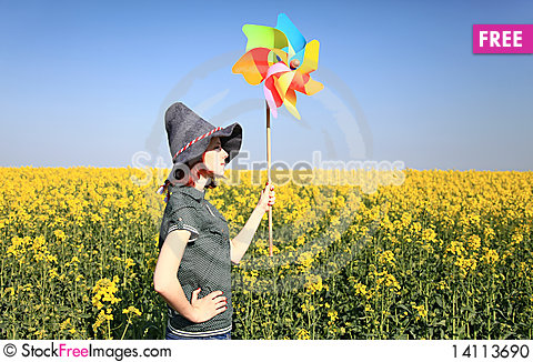 Free Girl In Cap With Wind Turbine At Rape Field. Stock Photo - 14113690