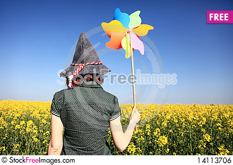 Free Girl In Cap With Wind Turbine At Rape Field. Royalty Free Stock Image - 14113706