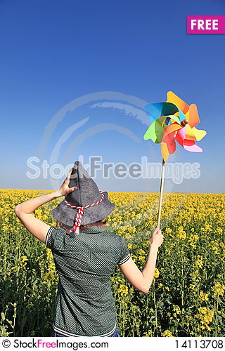 Free Girl In Cap With Wind Turbine At Rape Field. Royalty Free Stock Photos - 14113708