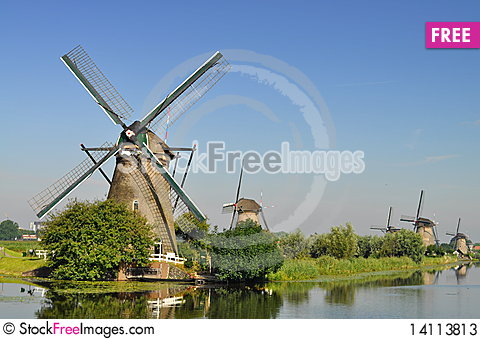 Free Dutch Mills Over A River Stock Photos - 14113813