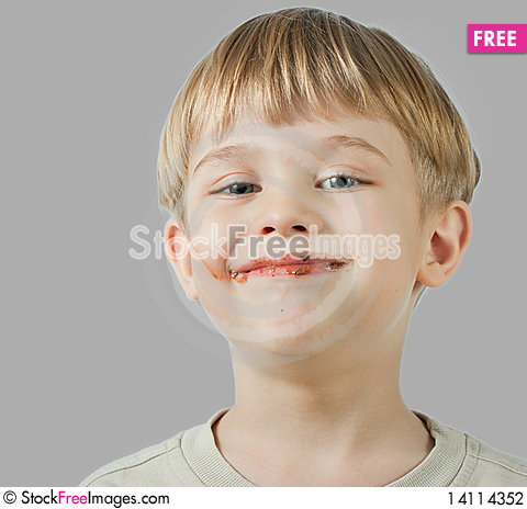 Free Cute Boy With Chocolate Face Stock Photography - 14114352