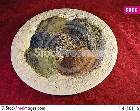 Free Spices On A Yellow Plate Royalty Free Stock Image - 14118116