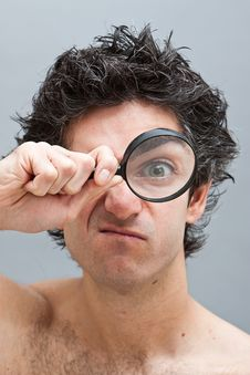 Free Curious Man With Magnifier Royalty Free Stock Photo - 14110255