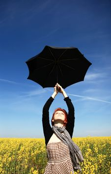 Free Girl With Umbrella At Rape Field. Stock Image - 14113811