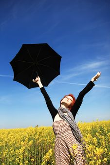 Girl With Umbrella At Rape Field. Royalty Free Stock Image