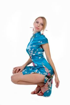 Beautiful Blonde In A Chinese Dress Stock Image